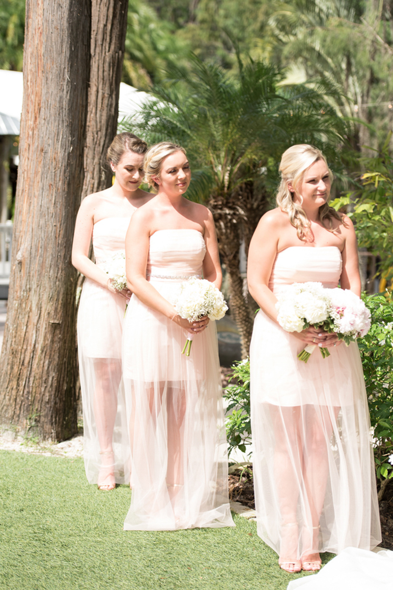 bridesmaids in short blush dresses
