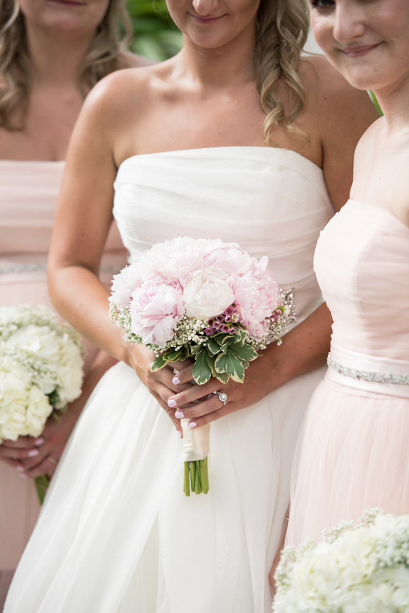 bride holding blush and white peony bridal bouquet