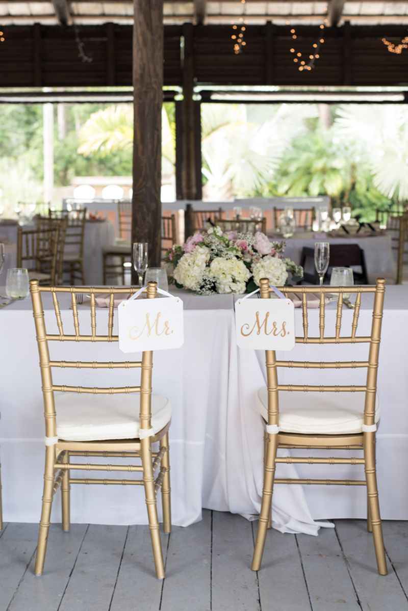 gold mr and mrs signs on gold chiavari chairs