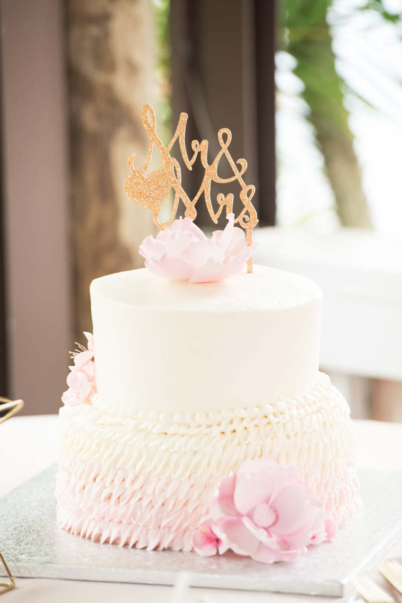 white and blush wedding cake with gold Mr and Mrs topper