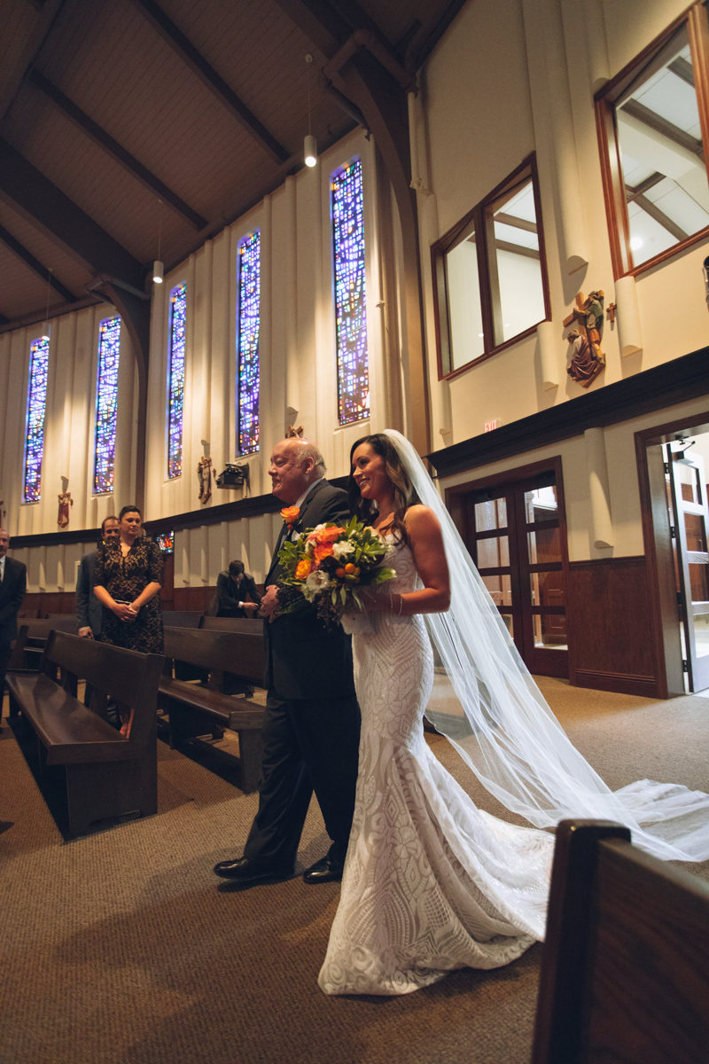 bride walking down the aisle at St. Margaret Mary's Catholic Church