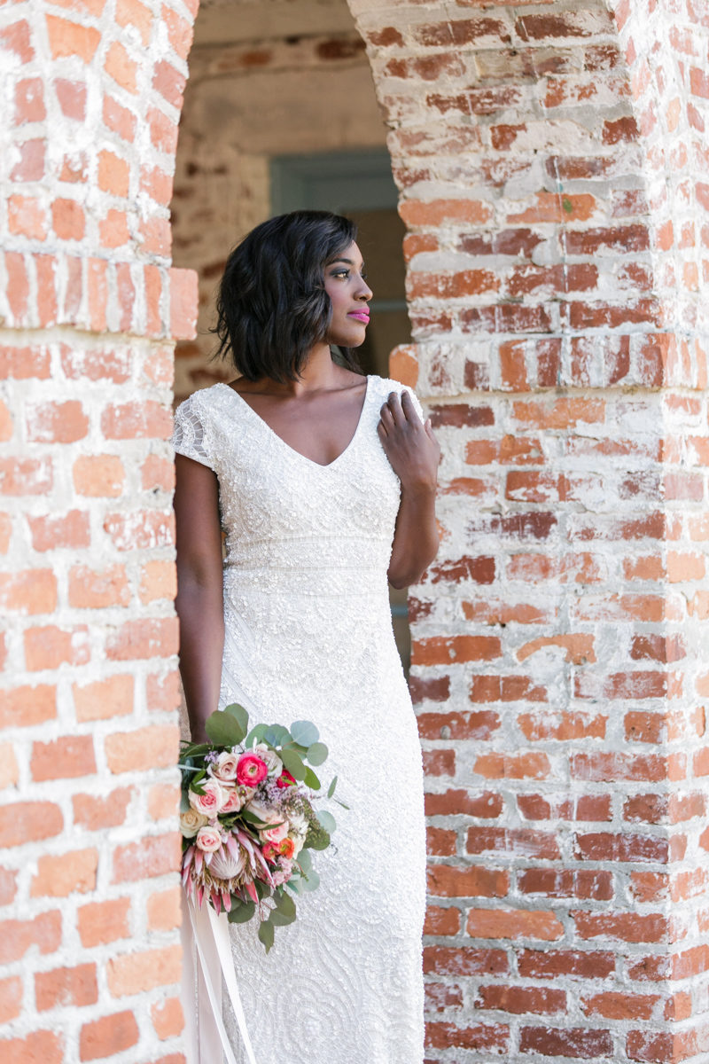 Bride standing in Casa Feliz arch in Theia Couture bridal gown