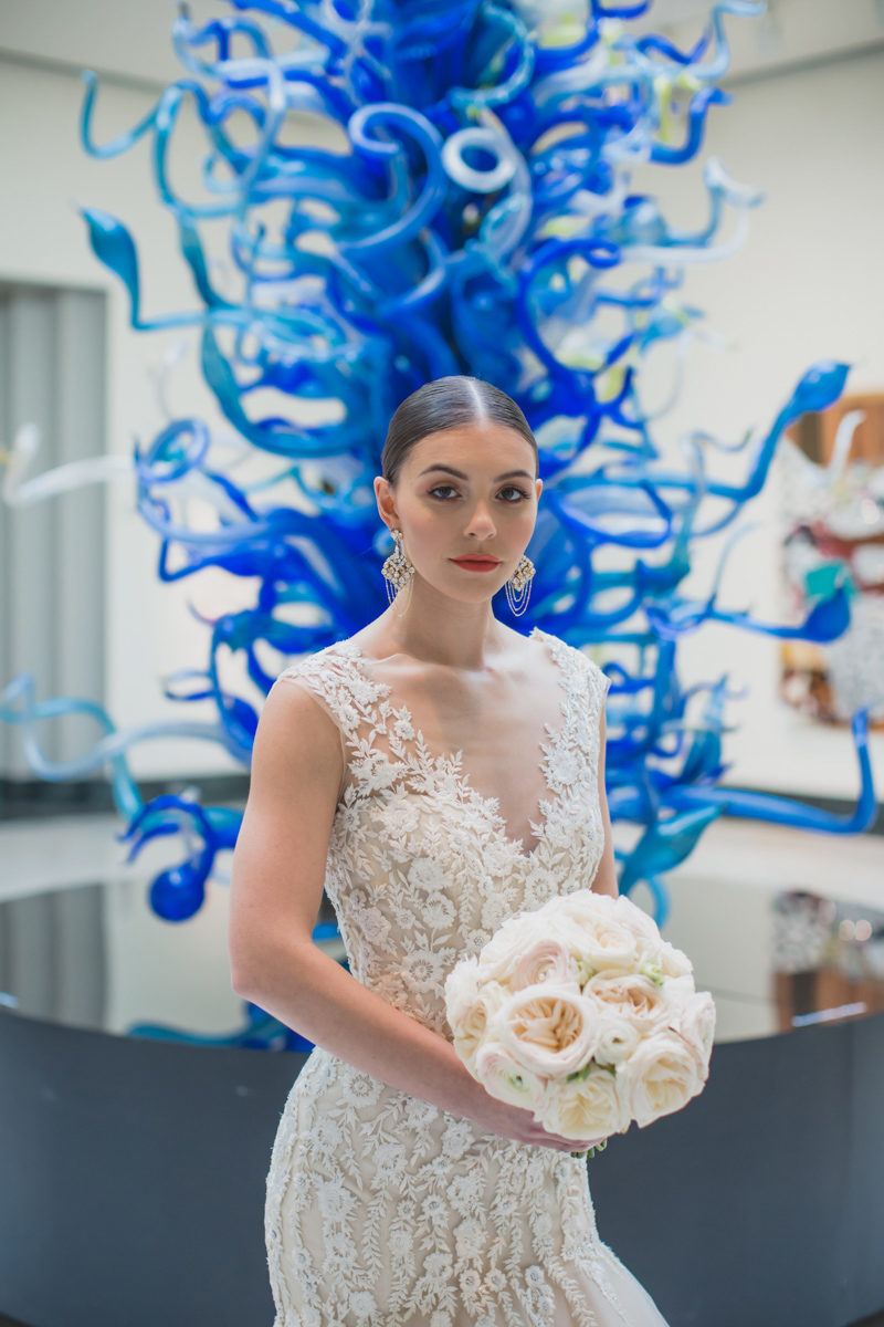 bride holding white garden rose bouquet at the Orlando Museum of Art