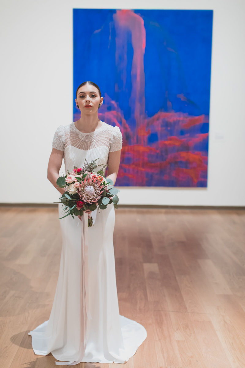 bride in front of painting at the Orlando Museum of Art