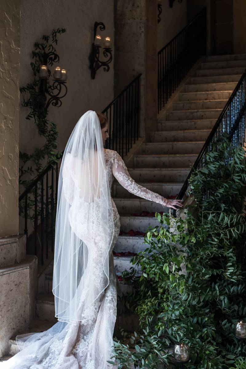 Long-sleeved lace wedding dress with veil