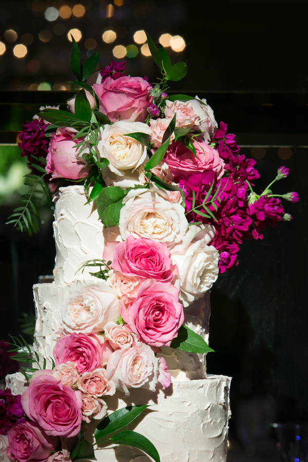 White buttercream wedding cake with pink flowers
