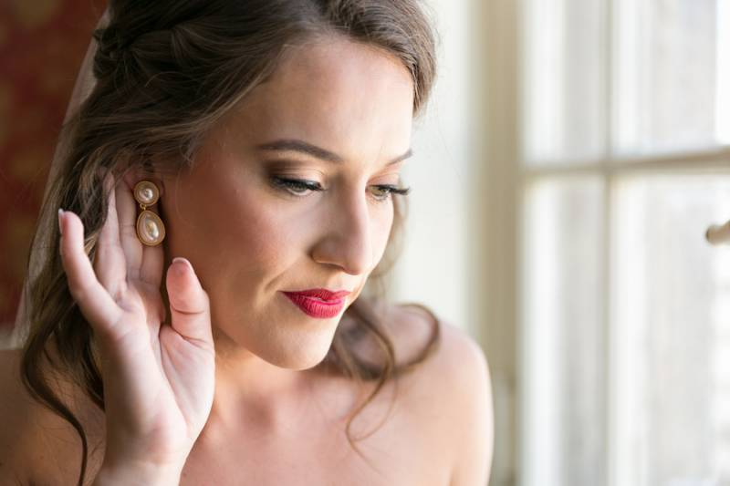 Soft wedding makeup with red lip