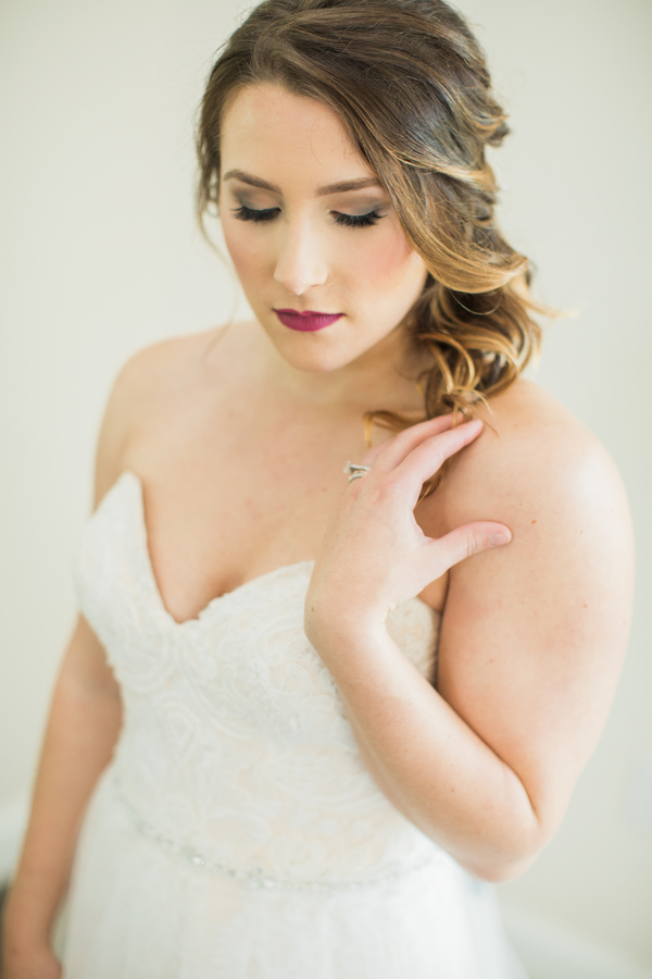 Soft romantic bridal makeup with bold lip