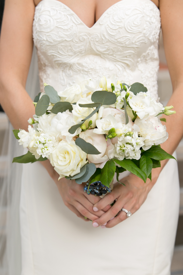 White bridal bouquet with green accents