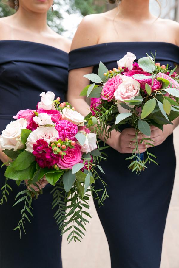 Pink bridal bouquets against blue bridesmaid dresses