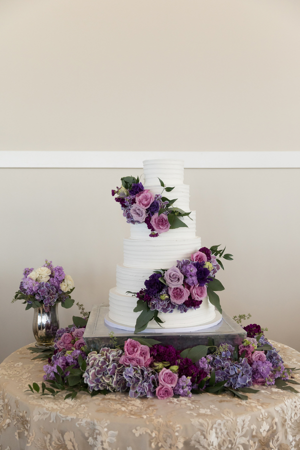 White wedding cake with purple flowers
