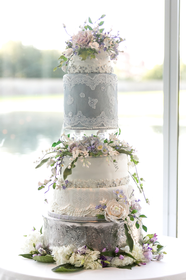 Gray and white ornate wedding cake