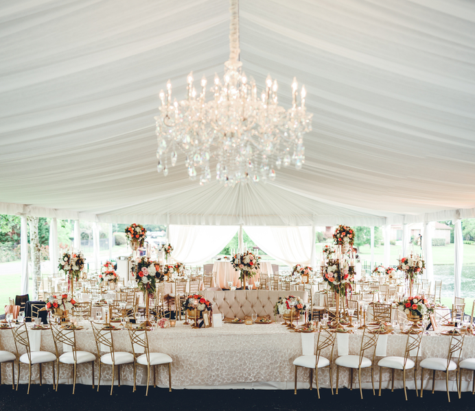 Blush and gold tented wedding reception space