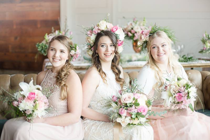 Neutral colored bridesmaids with flower crowns