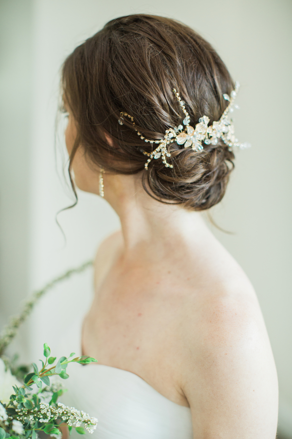 Bridal updo with crystal accessory