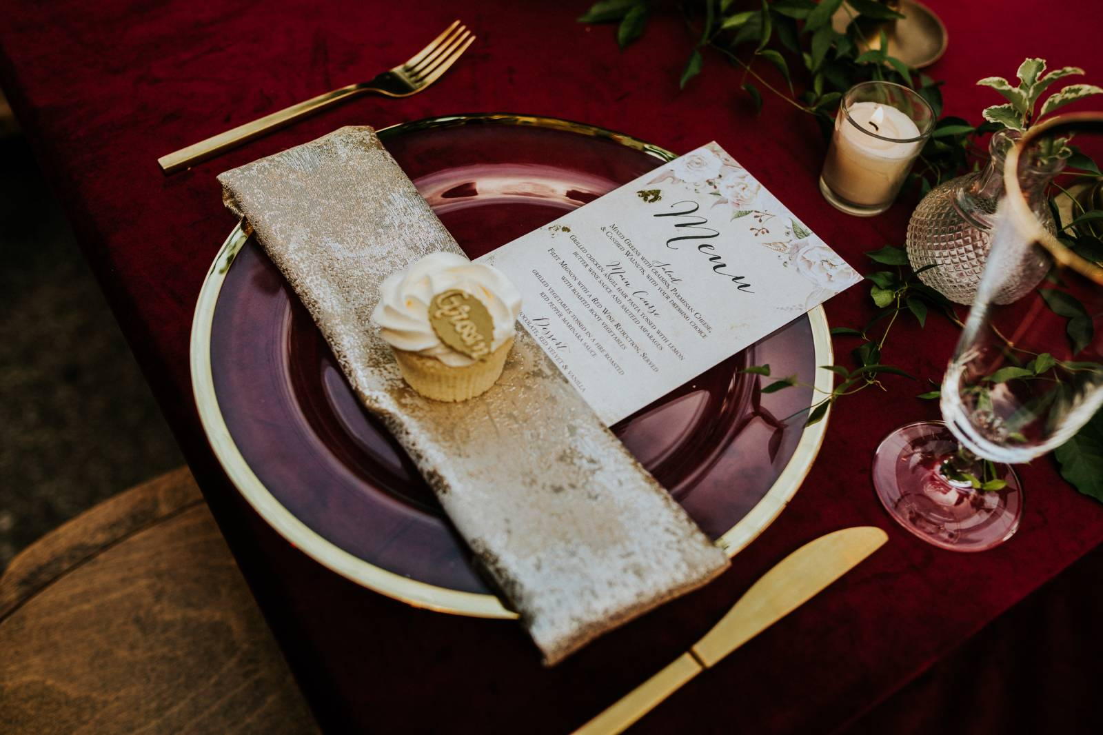Gold and burgundy place setting