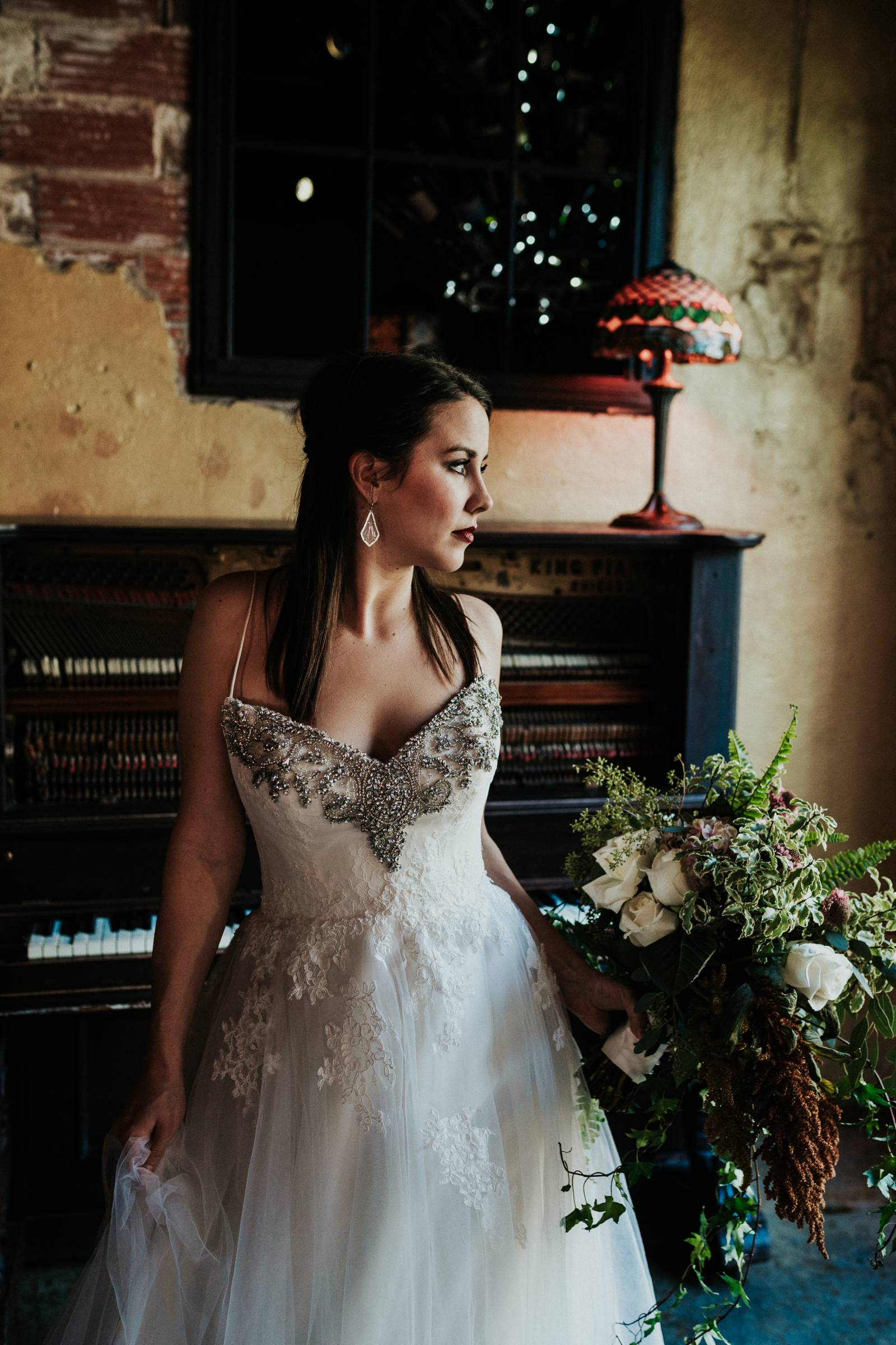 Jewel encrusted bodice on lace wedding dress