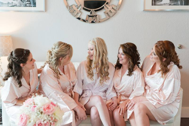 Bridesmaids in pink satin robes