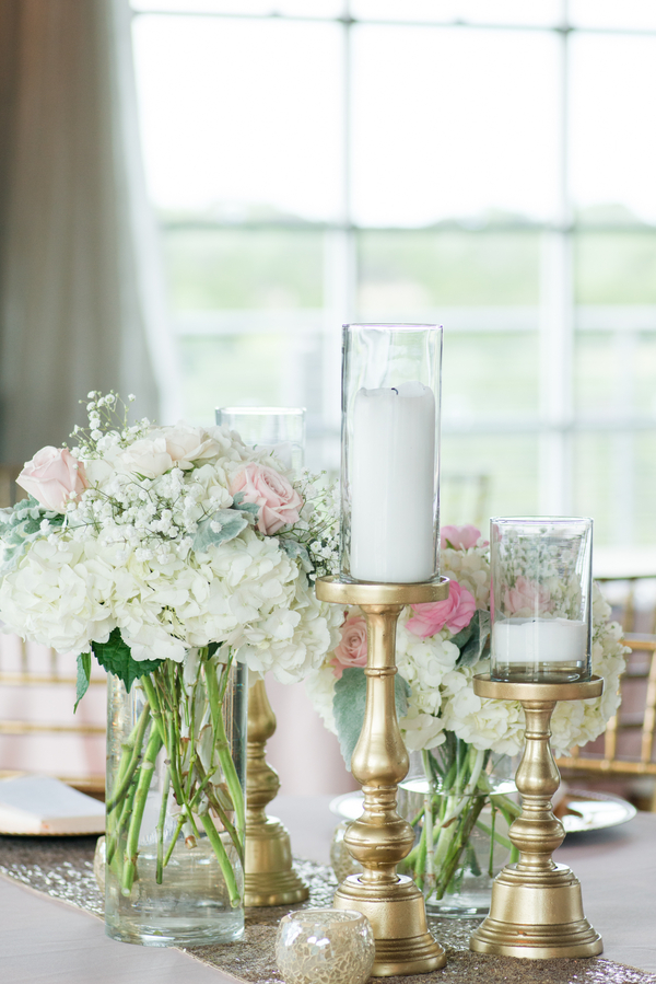 Cream and blush wedding centerpieces with pillar candles