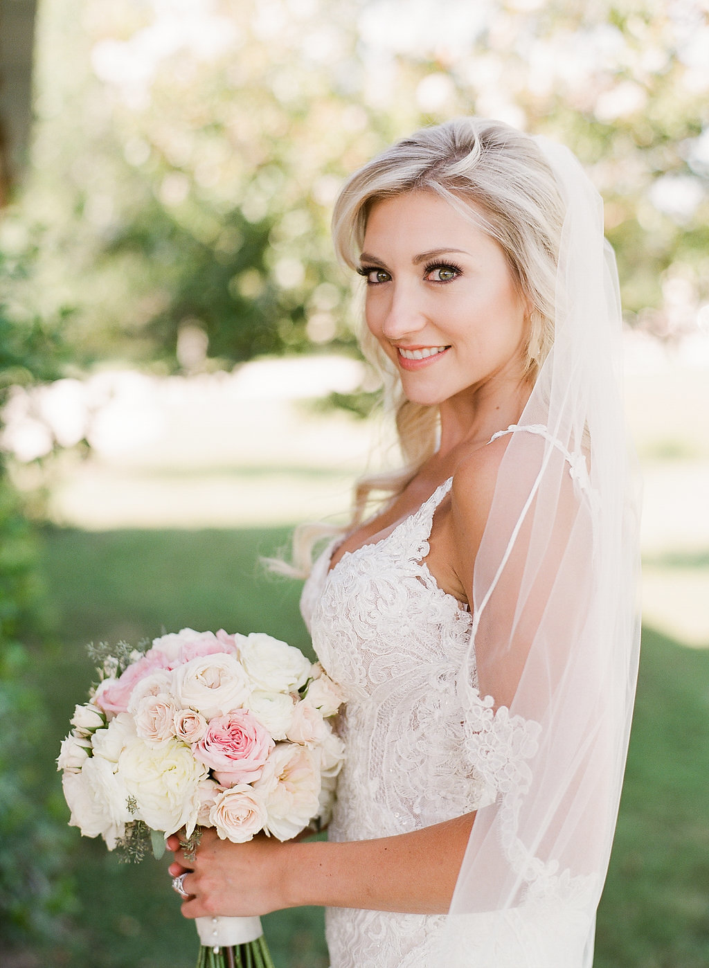 Beautiful bridal portrait with pink bridal bouquet