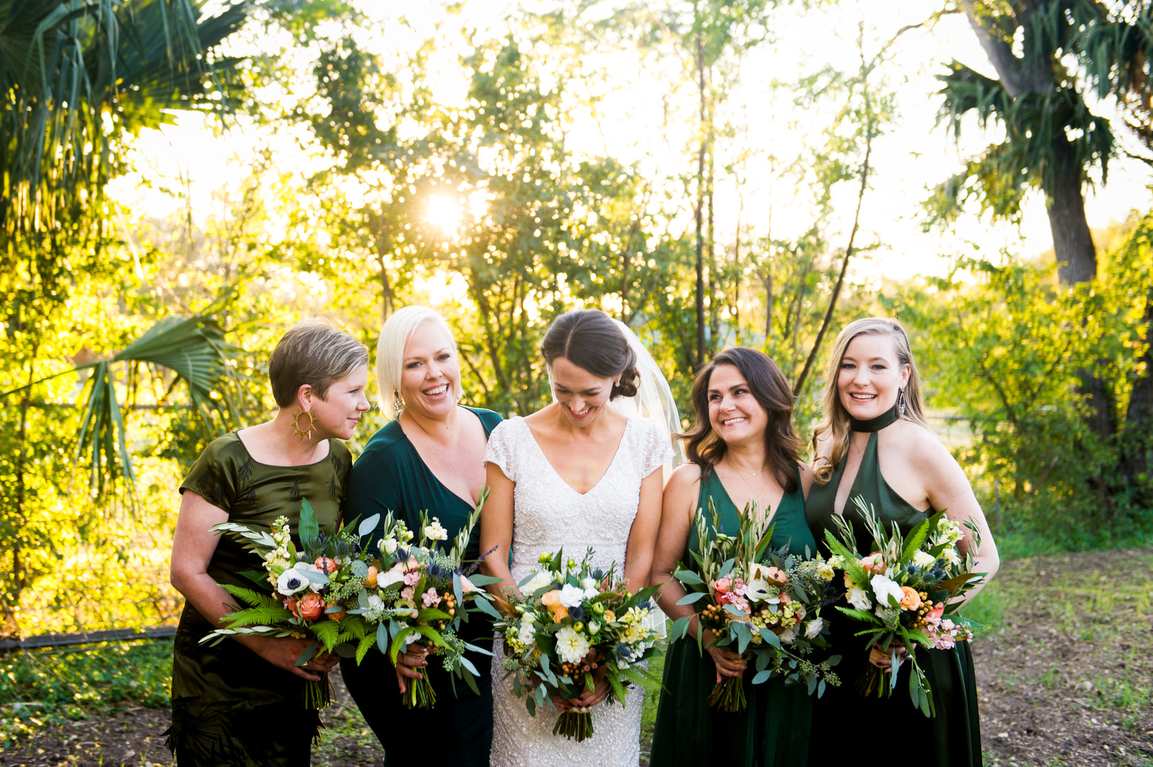 Green bridesmaid dresses and bouquets